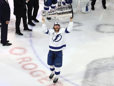 Tampa Bay Lightning player Brady Point skates across the ice with the Stanley Cup after winning the Stanley Cup in game six over the Dallas Stars. Photo by: Bruce Bennett/Getty Images