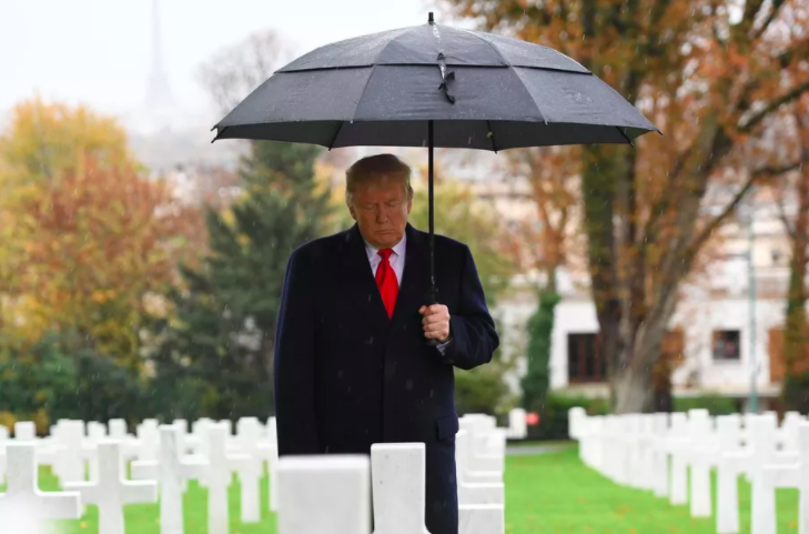 Donald+Trump+participating+in+a+ceremony+at+the+American+Cemetery+of+Suresnes+in+2018+as+part+of+a+Veteran%E2%80%99s+Day+commemoration.+Photo+by+Saul+Loeb.+
