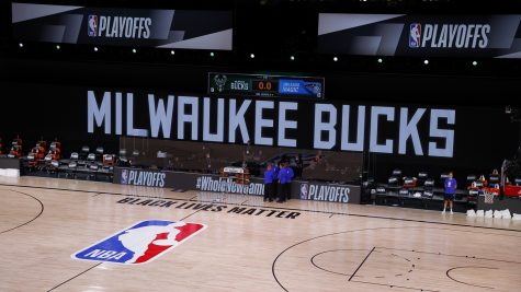 On August 26, the Milwaukee Bucks and the Orlando Magic protested their 5th Game of the NBA first-round playoff series leaving an empty court and refs alone in a huddle.  Photo by: (Kevin C Cox/Getty)