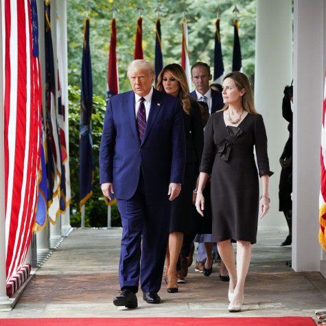 Amy Coney Barrett walks alongside President Trump to announce her nomination. Photo by Alex Brandon/AP