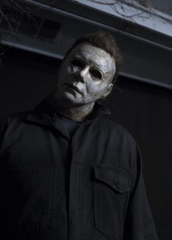 Michael Myers, from the horror movie movie Halloween, is doing his infamous head-tilt that is featured in all of his movie appearances.  Photo by Ryan Green/Universal