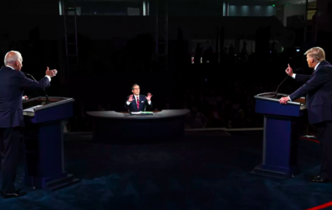 Joe Biden (left) and Donald Trump (right) debate at Case Western University in Cleveland, Ohio, while Fox's Chris Wallace (middle) struggles to moderate. Photo by Associated Press.