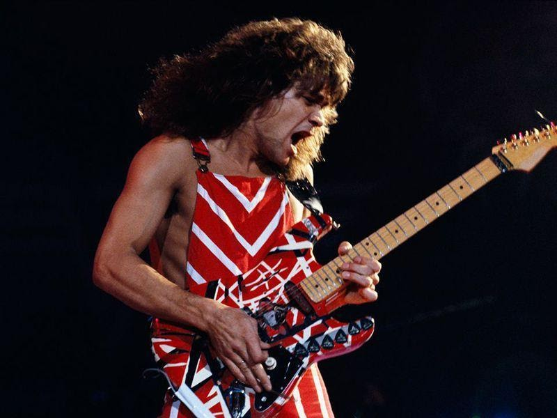 Van+Halen+performing+with+his+signature+striped+guitar%2C+originally+designed+with+electrical+tape.%0A%09%09%09%09%09%09%09%09%09++++++++Photo+by+Fabio+Nosotti.