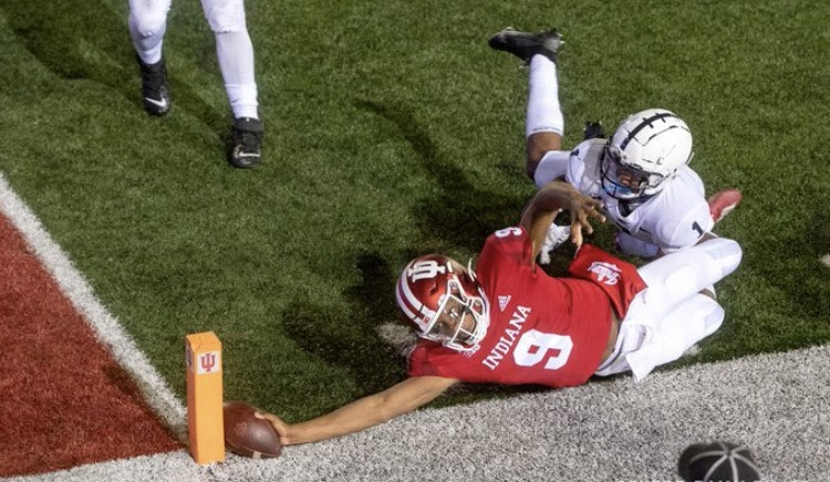 Indiana+quarterback+Michael+Penix+Jr.+stretches+for+the+pylon+to+score+the+game-winning+two-point+conversion+in+Indianas+36-35+upset+victory+over+Penn+State.+Photo+by+Indy+Star.%0A
