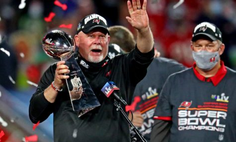 Feb 7, 2021; Tampa, FL, USA;  Tampa Bay Buccaneers head coach Bruce Arians celebrates with the Vince Lombardi Trophy after the Tampa Bay Buccaneers beat the Kansas City Chiefs in Super Bowl LV at Raymond James Stadium.   Mark J. Rebilas -USA TODAY Sports.