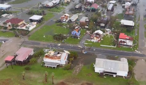 A U.S. Coast Guard flies over the destruction from hurricane Ida in Louisiana.