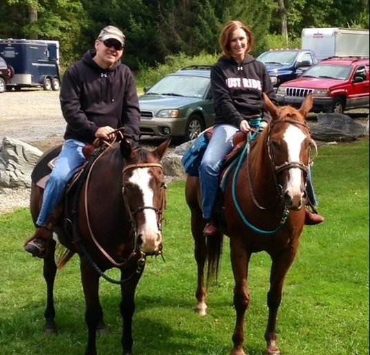 Robert Grove and his wife, Mary Beth Grove, enjoy horseback riding at their farm.