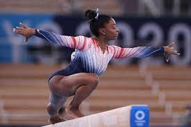 Simone Biles performs at the 2021 Tokyo Olympics which she withdrew from due to her mental health.